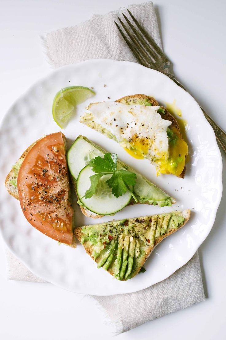Avocado toast, 4 ways. 1) sea salt, ground pepper & chili flakes 2) cucumber, lime juice & parsley 3) tomato, sea salt & pepper 4) over easy egg, salt & pepper.