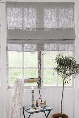 Simple, gauzy window shade.