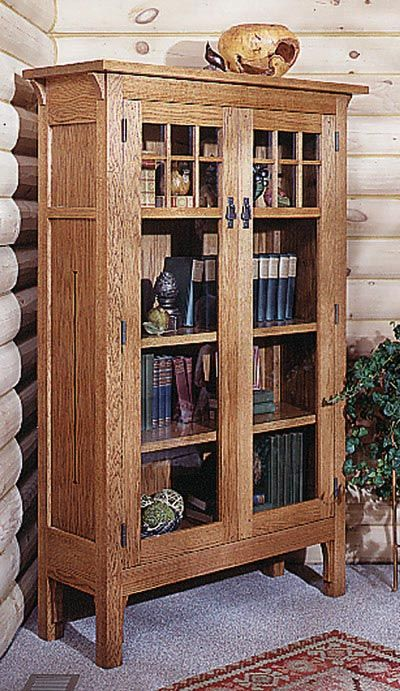"Simple, yet stunningly elegantAdd to the Arts-and-Crafts Collection set with this stately bookcase. We embellished ours with cutouts in the side panels, reproduction hardware, and glass-framed doors to capture the quality and ambiance of furniture from this era of craftsmen.  Measures 42-3/8 x 68""."