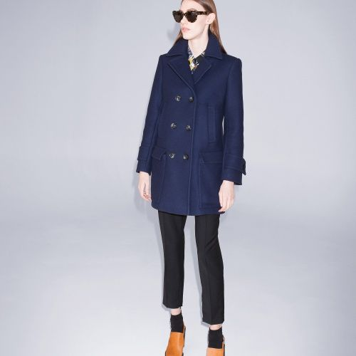 Africa is a classic peacoat in a luxe wool-blend. Slant pockets and patch pockets in front.