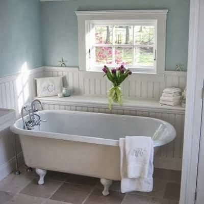 Claw tub with bead board behind, accept I want it to have shelves that come up behind it and a walk through shower behind it. YES PLEASE!
