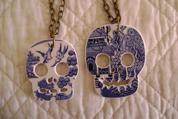 a couple of willow pattern china skull pendants.