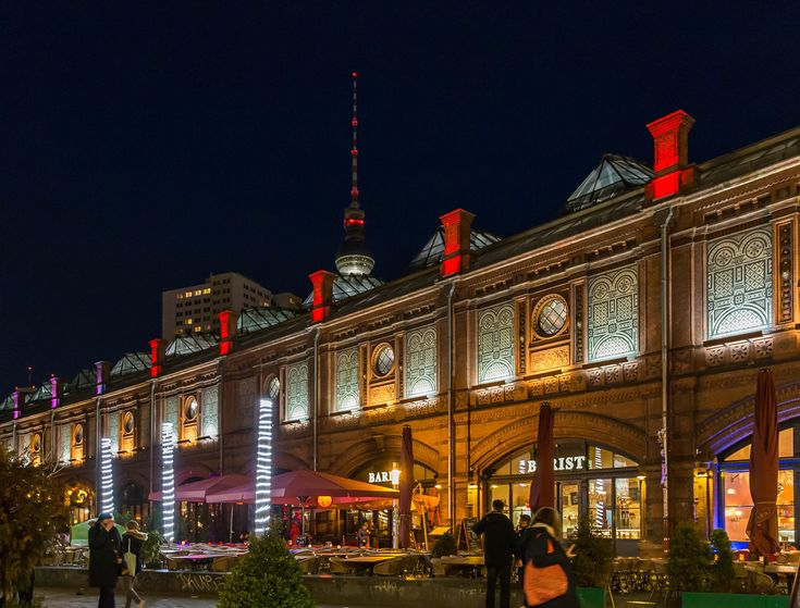 Berlin, Germany - May 16, 2016: night view of the Hackescher Markt S-Bahn station in Berlin. The building for the elevated S-Bahn was opened 1882 and built in Italian Renaissance style.