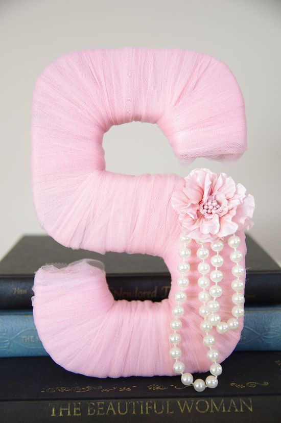 Tulle wrapped letter: get cardboard letter from michaels, wrap with tulle, hot glue a strand of pearls and a flower to fit your little girls #modern house design #modern home design| http://homedesignmarcellatriston.blogspot.com