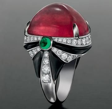 Amazing Cocktail ring with dark ruby and diamonds.