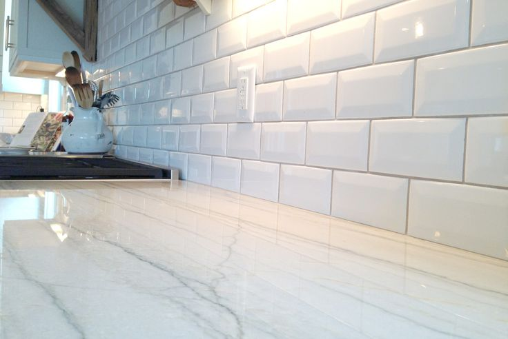 White Macaubus Quartzite.  Sturdier than granite.  No scratching or staining.  Looks JUST like marble!