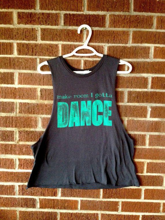 That's right.   Gotta Dance Eco Friendly Muscle Tank Deep Side Cut  by EnterTheSun, $35.00