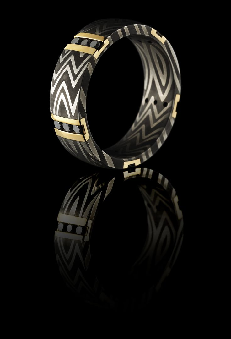 wedding bands mud tire wedding rings JCK Jewelers Choice Award Winner This ring is so unique Damascus 14K