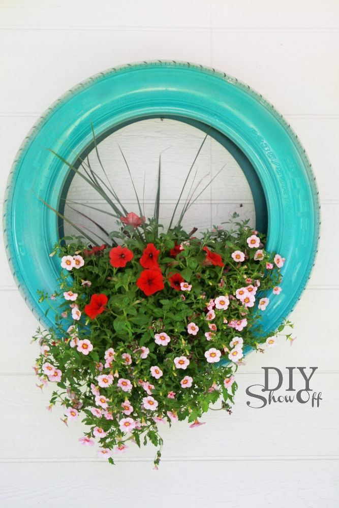 Not a new idea, but a fun one. Tire flower planters two ways: wall mounted and…