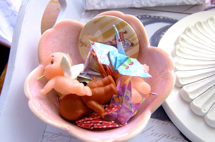 Miscellaneous Japanese lotus dish filled with kewpies and paper cranes.