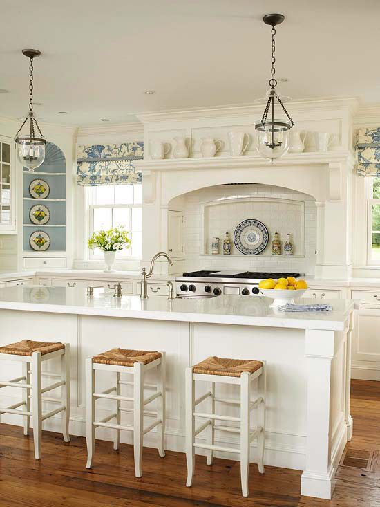 Pretty and fresh.  Why doesn't anyone put the cooktop in the island?  Can't you just imagine shoveling of french toast, omlettes, grilled cheese sandwiches, etc. to the starving masses?  I like the stove nook except for my sink.
