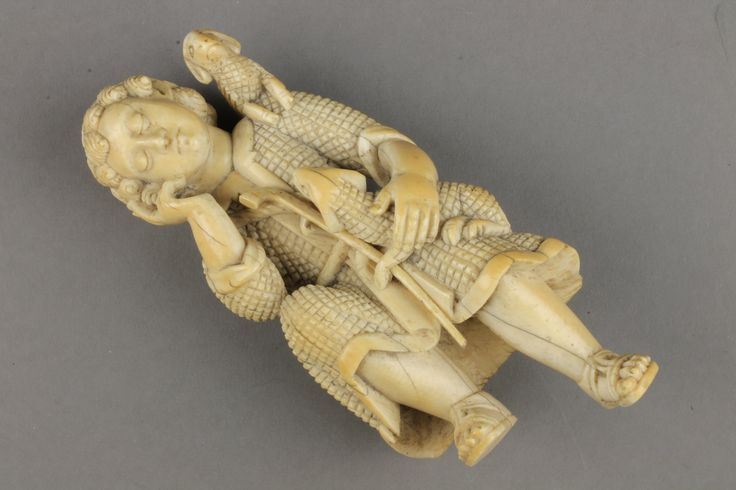 "Lot 844, An 18th Century Continental ivory carving of a seated shepherd with 2 sheep holding a staff and wearing a pilgrim's flask about his waist 7"", est  £150-250"