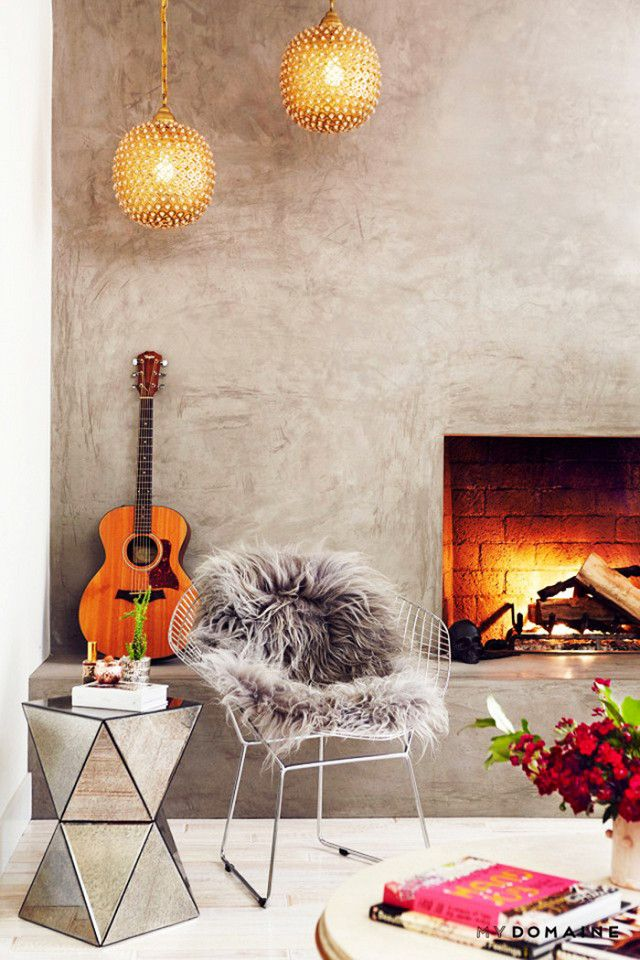 When it comes to styling a modern fireside situation, we love to start with a neutral palette and layer on tons of texture. The clean, modern finish of a concrete fireplace is an ideal canvas for...