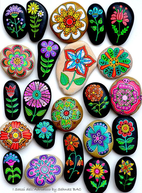 Beach stones with hand-painted designs in acrylics © Sehnaz Bac 2017  I paint and draw all of my original designs by free hand with the small brushes or paint pens with extra fine tip. I use also different inks. No stencils are used. All designs are created with my imagination.