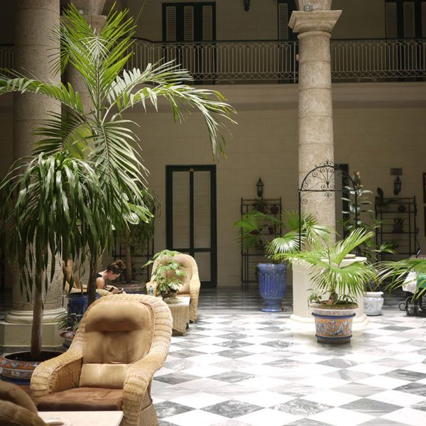 """Stay at Hotel Florida for an upscale boutique hotel experience in the ultra charming Old Havana neighborhood (think: ceramic arches, tiled floors and palm fronds). There's live Cuban music in the beautiful open-air lobby at night."