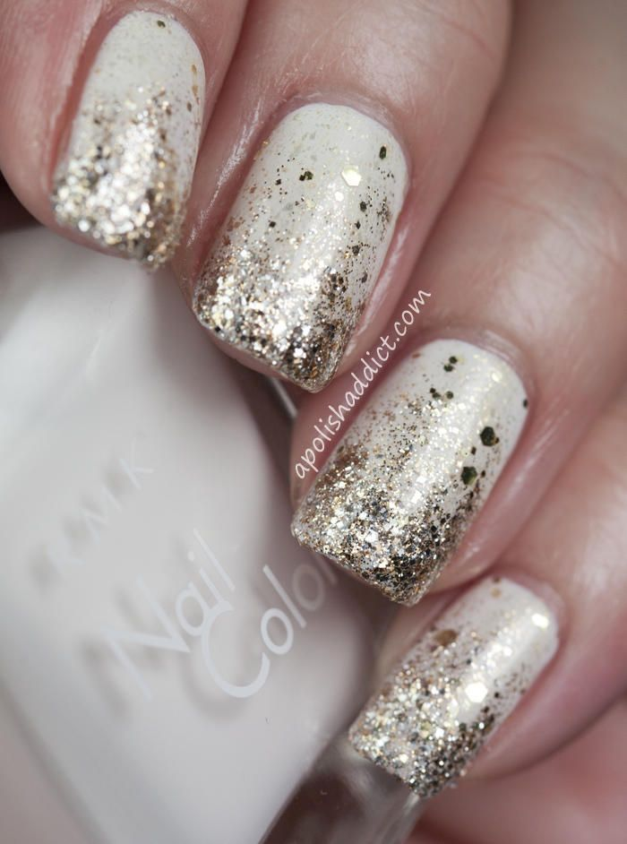 Gradient has been huge this year. Combine it with glittery gold to ring in the new year with this tutorial from A Polish Addict. Start with two coats of solid off-white polish. For extra gold glimmer, swipe a coat of gold glitter nail polish like Deborah Lippmann Boom Boom Pow to give the white a gold sheen. Use a normal nail brush to paint on a more concentrated gold glitter polish, and sponge extra-close to the tips for a gorgeous gradient look.