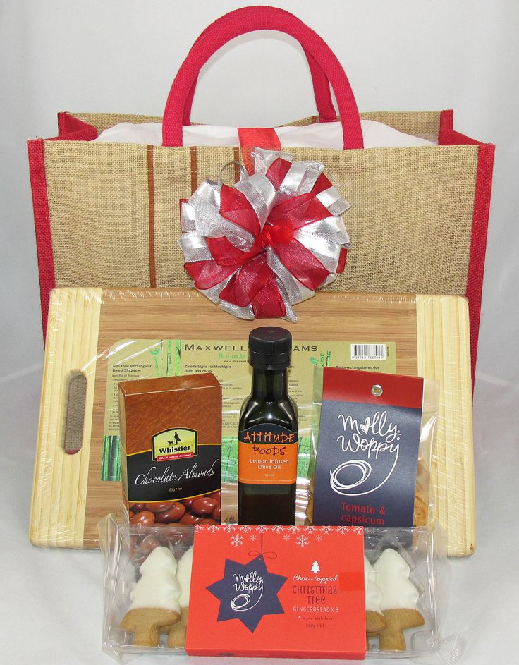 Corporate Christmas Gift. Large reusable environmentally friendly jute bag containing: olive oil infused with lemon, large wood breadboard, iced Christmas cookies, chocolate almonds, crostini, $78. funkygiftboxes.co.nz  #AucklandGiftHampers #CorporateGiftBaskets