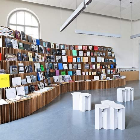 The UdK Bookshop was made from 600 corrugated-cardboard panels that were cut, folded and glued to create a lattice structure. Love the shape!