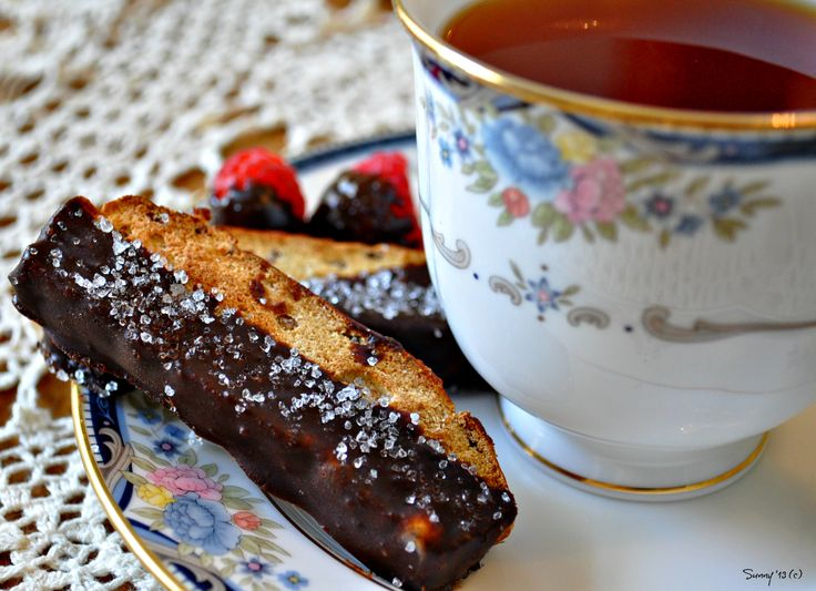 THM Biscotti - 1/4 cup oat fiber, 3/4 t glucomannan, 1/2 t baking powder, 2 t Truvia,1 t orange extract,1/2 t almond extract, 1 T unsweetened cranberries chopped, 1/3 c egg whites, 2 T water Mix dry ingredients together well and then add remaining. Grease two mini loaf pans; divide mixture. Bake 25-30 min. @ 350. Slice into four pieces and bake for 30 minutes, turning once or until crispy.  Cool. Dip in skinny chocolate.  Freeze until chocolate hardens.  Photo by Sunny Clark all rights…