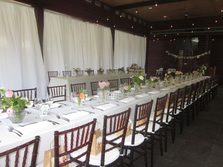Bulb Lighting over the long table and Mahogany Tiffany Chairs