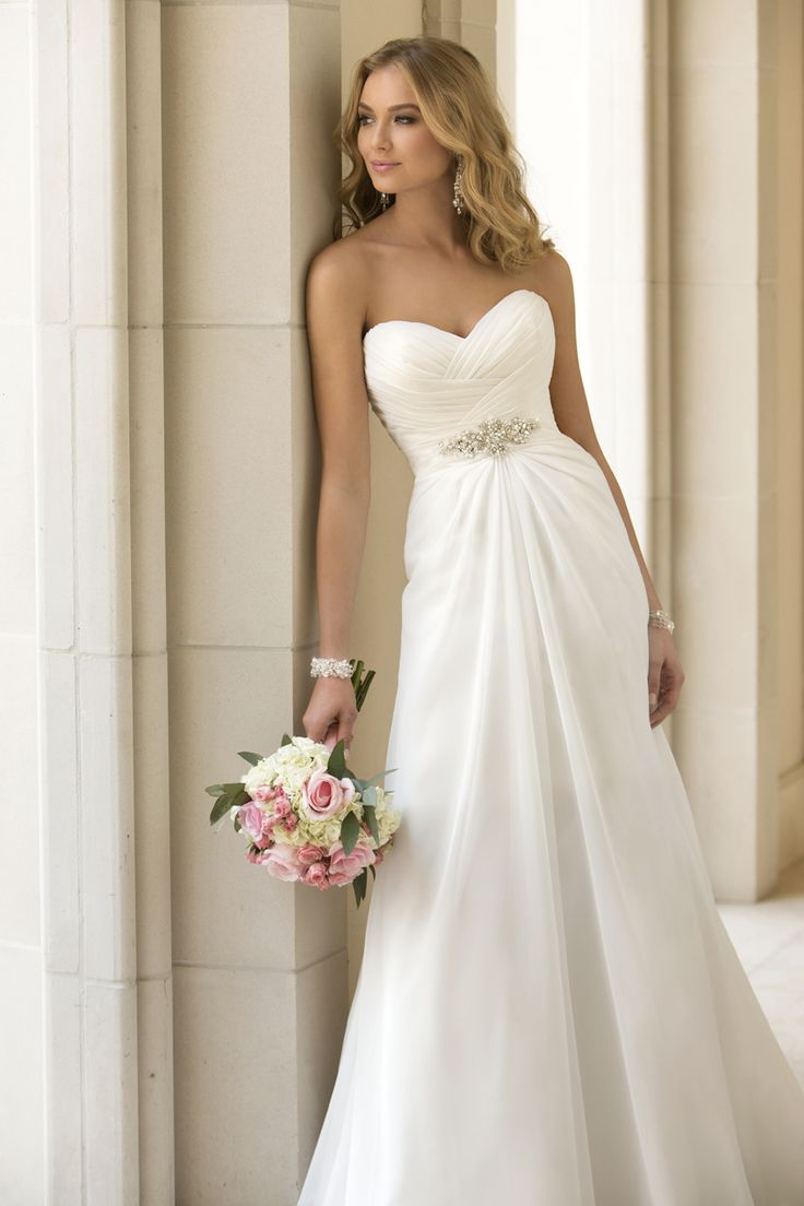 Call (920) 662.1920 to see this gown Style #5933 Gown by Stella York simple always goes a long way.