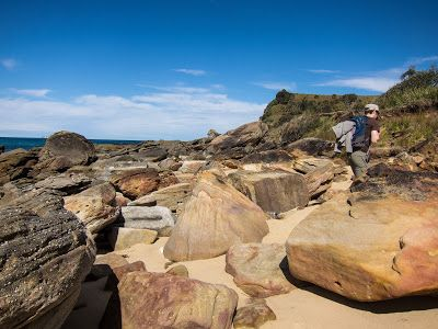 Walking along the rocky passage towards the prominent headlands in search of the Figure 8 Pools - Otford to Figure 8 Pools Circuit, Royal National Park
