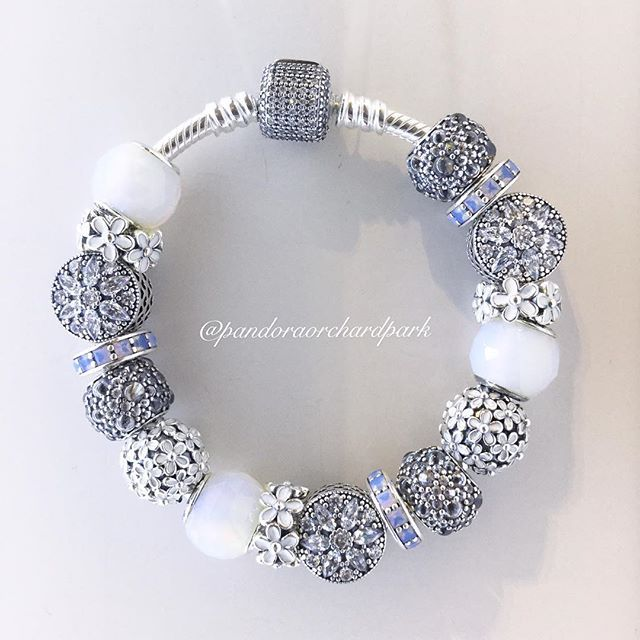 We're loving the clean look of the clear cubic zirconias with the darling daisy…