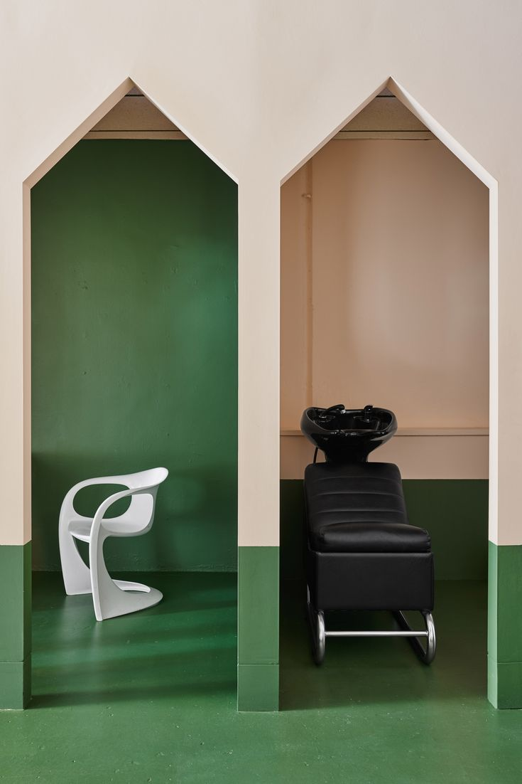 The bold colours and geometric shapes used throughout this hair salon in Melbourne are based on the works of postmodernist designer Ettore Sottsass.