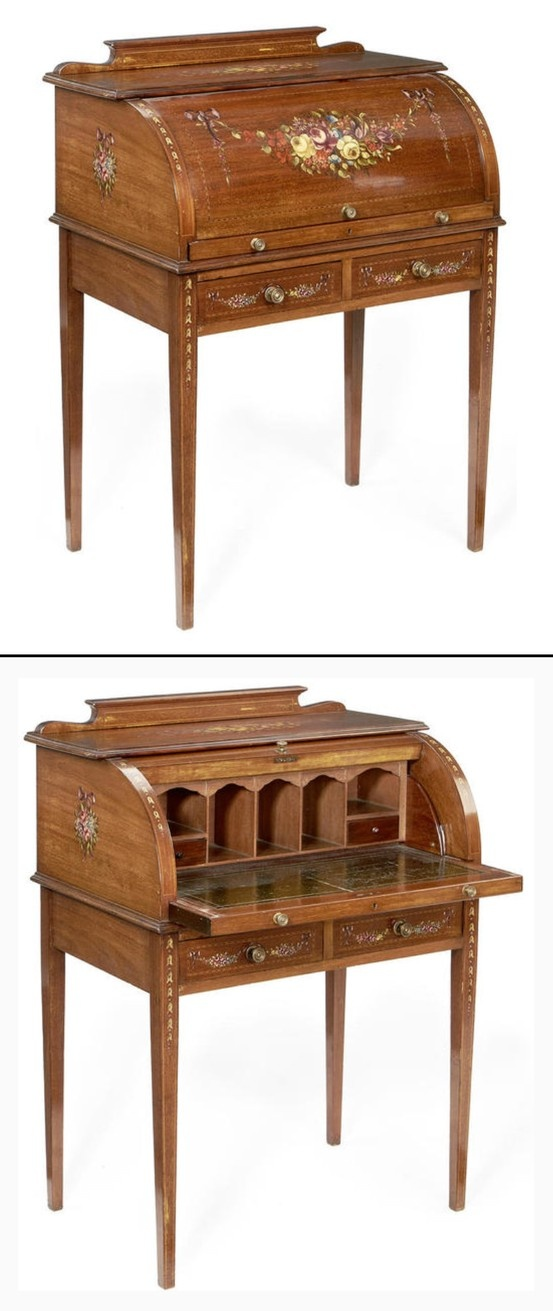 An Edwardian mahogany and polychrome decorated roll-top cylinder desk of small proportions, painted with an assortment of flowers, floral swags and bellflower pendants, the shaped gallery back above a roll-top enclosing five pigeon holes, two short drawers and a leather inset writing slide, over two short drawers, on square tapering legs