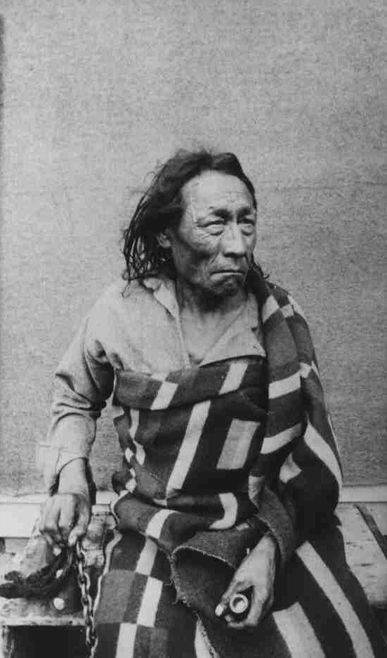 Photograph of Chief Big Bear (1828-1889) (Mistahi-maskwa) taken during his trial outisde the North West Mounted Police Barracks in Regina. Cree - Plains. Contributer Otto B. Buell. Date Range(s): 1880-1889.  University of Saskatchewan Archives.  George Gwynne Mann Family Fonds.