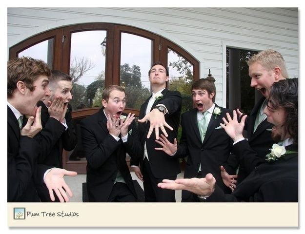 Groomsmen checking out the groom's ring - 42 Impossibly Fun Wedding Photo Ideas You'll Want To Steal