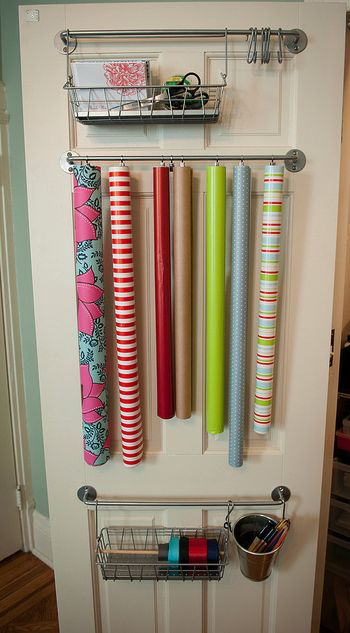Gift Wrap Organizer {diy} ~ Here is a great way to utilize a closet door for gift wrapping supplies.  All of the bars and clips were purchased at Ikea for $20.