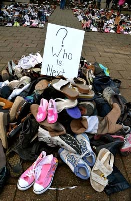 Victims' rights group Families for Justice set up 1,074 pairs of shoes outside the Surrey provincial courthouse on Saturday, Nov. 24 to raise awareness about drunk driving. Each set of shoes represented a person killed in Canada last year.