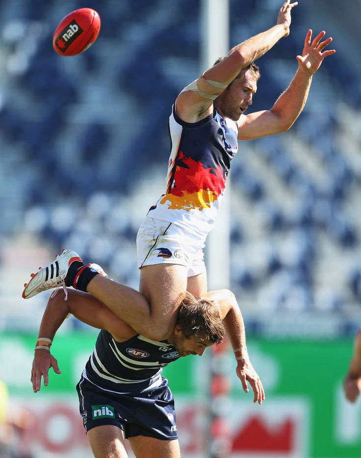 Jason Porplyzia of the Crows attempts to take a mark on the shoulders of Corey Enright of the Cats during the round two AFL NAB Cup match between the Geelong Cats and the Adelaide Crows at Simonds Stadium on March 2, 2013 in Geelong, Australia. (Scott Barbour / Getty Images)