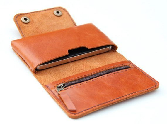 Leather iPhone wallet case in Orange Brown - with zipper and cards slot. $35.00, via Etsy.