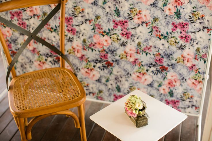 A Chair & Coffee Table with Floral Back Drop