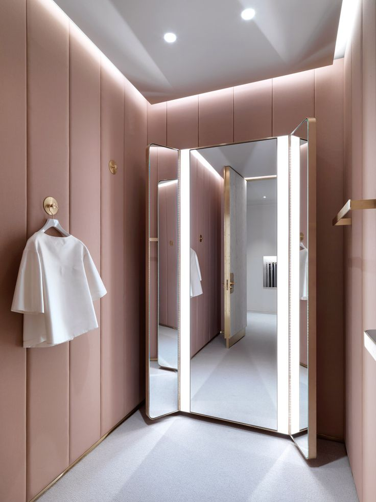 Soft tones & metallic details feature across the two floors of this London boutique designed by Universal Design Studio for fashion brand J&M Davidson.