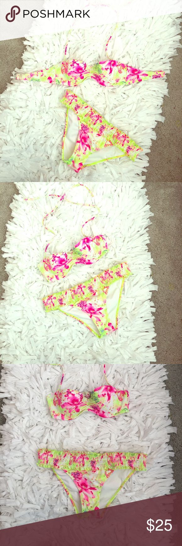 Victoria Secret 32B top and S bottoms Bikini Great preowned condition.  Top is size 32B.  Stiff very lightly padded cups with underwire top.  Top can be worn bandeau style or with removable halter straps.  Silver clasp in back.  Bottoms are a size Small with frilly riches elastic waistband.  Super cute bikini from Victorias Secret.  Bundle and Save. Victoria's Secret Swim Bikinis