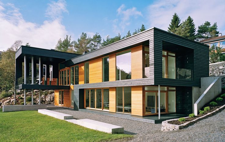 """Bergen-based studio Saunders Architecture has designed Villa Storingavika. Completed in 2008, this two story contemporary home is located on the outskirts of Bergen, Norway. Villa Storingavika by Saunders Architecture: """"Overlooking breathtaking fjords and a stretch of Norway's west coast archipelago, Villa Storingavika is a robust yet refined vessel from which to appreciate the delicate coastline and sometimes rugged climate. It is a pale timber volume enrobed in a crisp, 'pleated'.."""