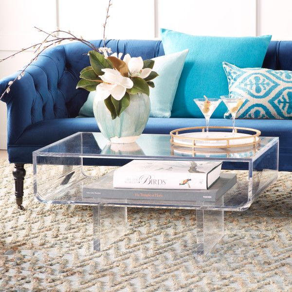 The Modern Acrylic Coffee Table Features An Expansive Table Top