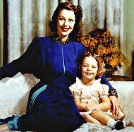 Judy Lewis, Secret Daughter of Hollywood. Her mother was Loretta Young and her father was Clark Gable. He was married to someone else when they had the affair. Loretta was so worried about her career. She had the baby overseas and the child was actually placed in a orphanage for some time.