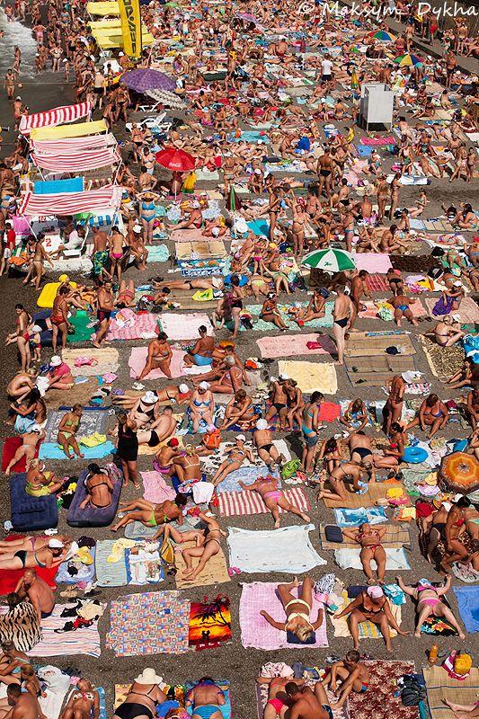 Sudak beach. Crimea, Ukraine  This reminds me of HB by the pier