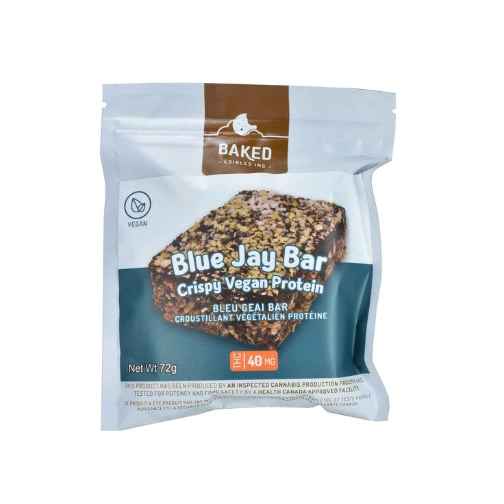 Baked Edibles - Vegan Blue Jay Bar - The Healing Hut Dispensary -  Made with pumpkin protein powder, these bars are both mouth-watering andextremely easy to digest. A carefully crafted combination of dark chocolate, crispy rice, almond butter and coconut nectar make for a perfect combination of crispy, chewy and sweet. Chock-full of wholesome ingredients you can feel good about! Each bite will leave you wanting more. 40mg THC Piece.