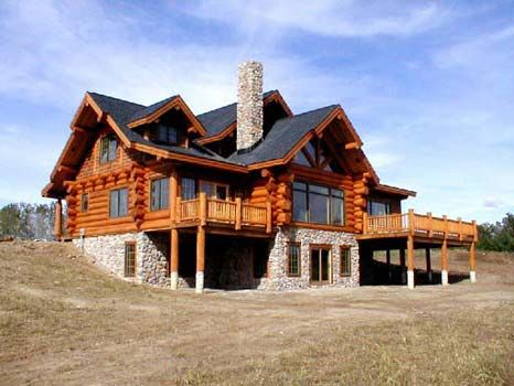 beautiful log home...walk-out basement. I want this someday!!!!