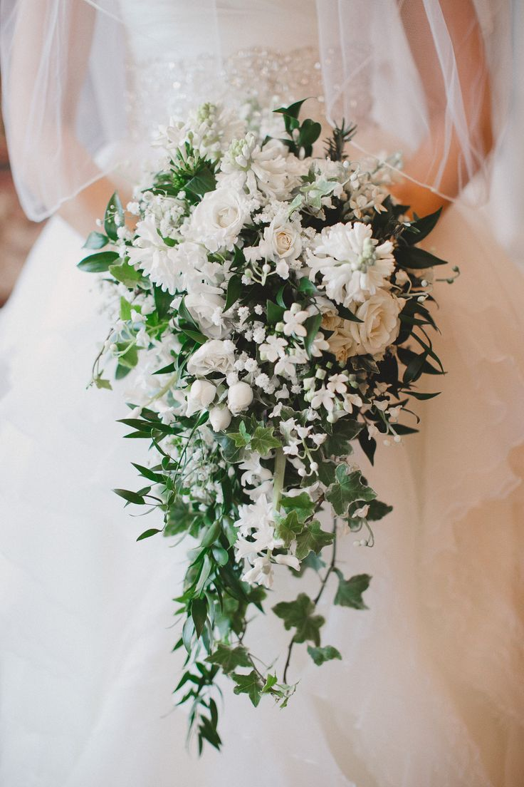 Cascading bouquet. Pictured: Bouvardia, Lilly of the Valley, Hyacinth, Spray Rose, Baby's Breath, Ivy, Italian Ruscus. By Fache Floral Designs.