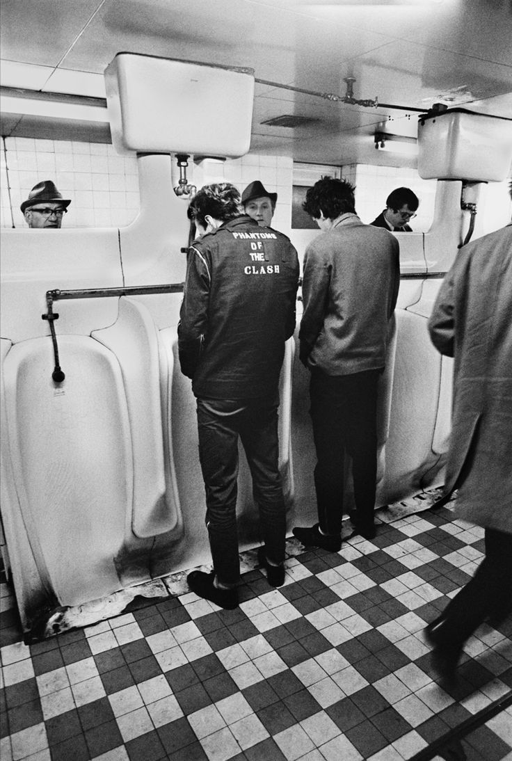 The Clash members Mick Jones and Joe Strummer photographed by Chalkie Davies at London Underground's public bathroom.