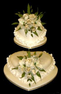 Many heart shaped wedding cakes pictures to inspire your wedding cake for that special day you have been dreaming about. The following examp...
