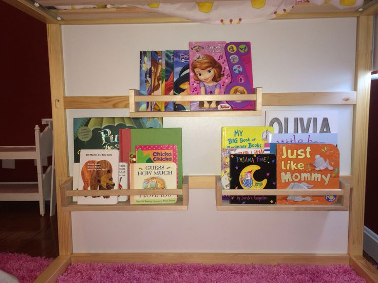 $4.00 spice wracks as book shelves on ikea Kura Bed
