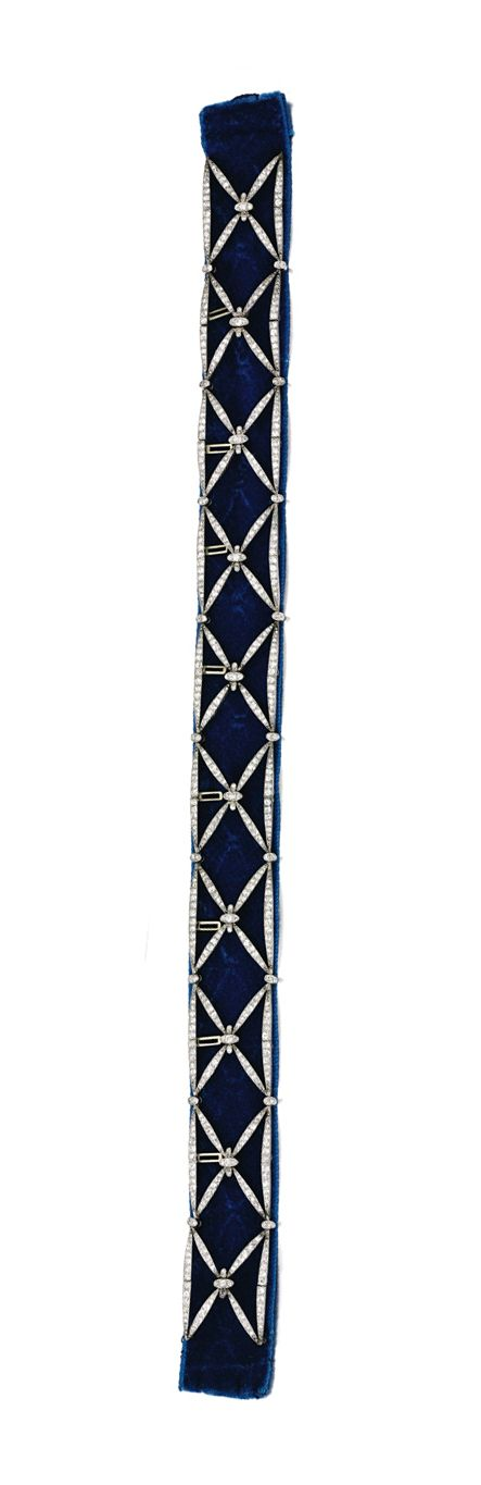 DIAMOND CHOKER, CIRCA 1900.  Designed as a series of cross motifs set with circular-, single-cut and rose diamonds, length approximately 325mm, photographed against a dark blue velvet ribbon.