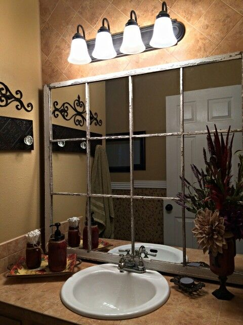 bathroom mirror created from a large window frame found beside the road in dallas